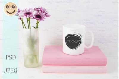 Coffee mug mockup with lilac daisy