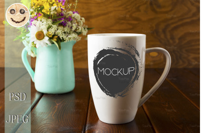 Coffee mug mockup with mint green flowerpot