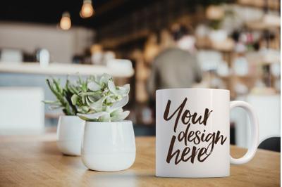 white coffee mug mockup in a restaurant setting