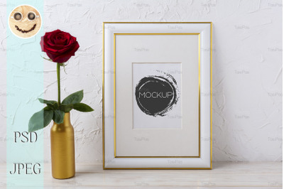 Frame mockup with burgundy red rose in golden vase