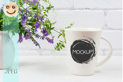 White coffee latte mug mockup with purple bird vetch.