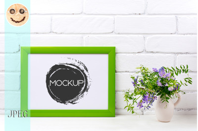 Green landscape frame mockup with purple bird vetch