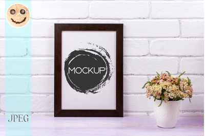 Black brown  poster frame mockup with pink yarrow