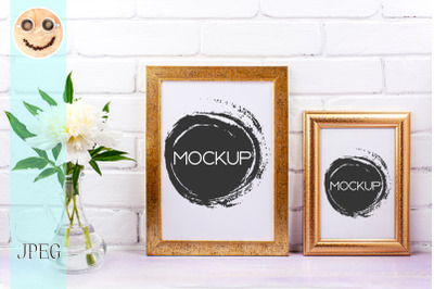 Two golden poster frames mockup with white peony