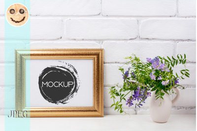 Gold decorated landscape frame mockup with bird vetch