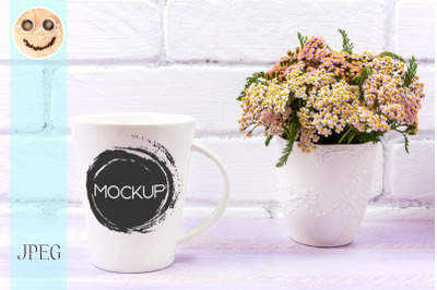 White coffee latte mug mockup with pink yarrow