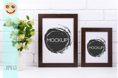 Two black brown poster frames mockup with spirea branch