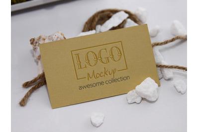 Logo Mockup with white stones and seashels design