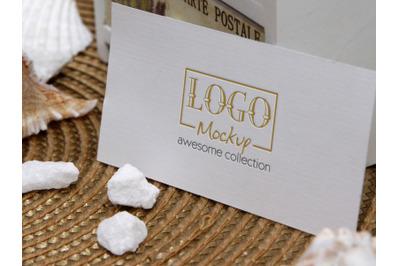 Logo Mockup on White Stones and Seashels