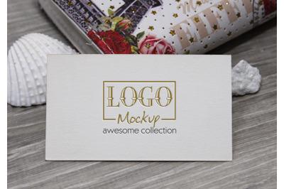 Logo Mockup with white stones and seashels