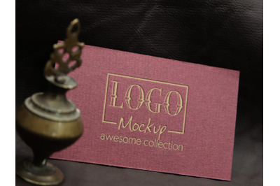 Logo Mockup with vintage miniature lamp design
