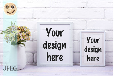 Two white poster frames mockup with pink yarrow.
