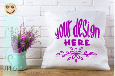 Pillow mockup with magenta wildflowers.