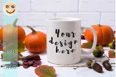 White coffee mug mockup with pumpkins, acorns.