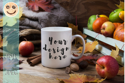 White coffee mug mockup with fall leaves and knitted plaid.