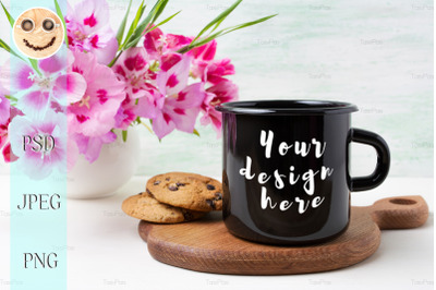 Black campfire enamel mug mockup with pink clarkia flowers.