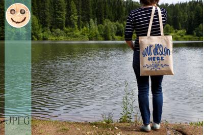 Woman standing with tote bag, mockup
