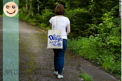 Walking woman holding tote bag mockup.