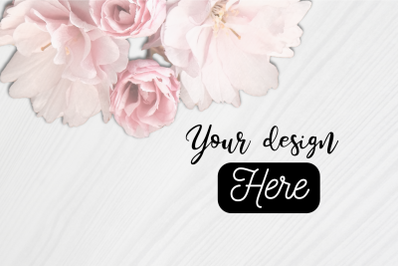 Mockup background with white wood and pink flowers