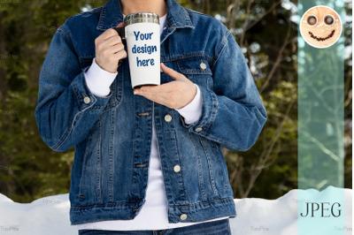 Travel mug mockup of a woman in denim jacket.