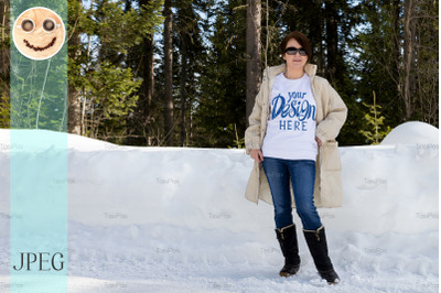 White sweatshirt mockup of a woman wearing black snow boots.