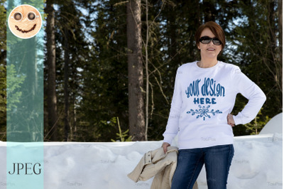 White sweatshirt mockup of a woman in the winter forest.
