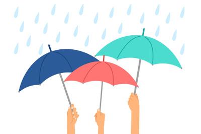 Hands holding umbrellas