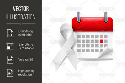 White awareness ribbon and calendar