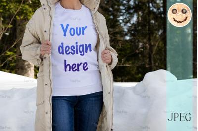 White sweatshirt mockup of a girl in beige quilted  jacket, model mock