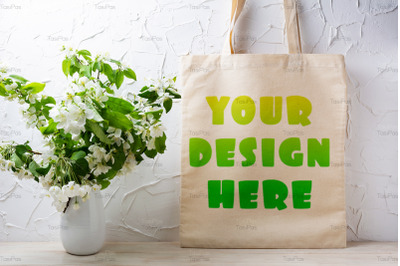 Rustic tote bag mockup with  flowering apple tree branch