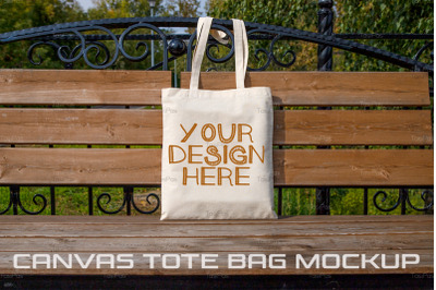 Rustic tote bag on the park bench mockup.