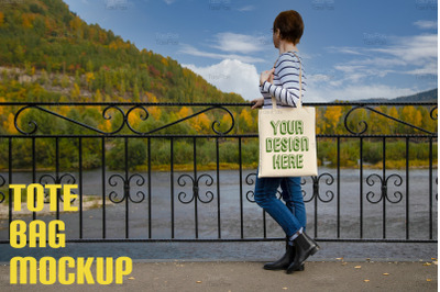 Woman in striped long sleeve shirt holding canvas tote mockup