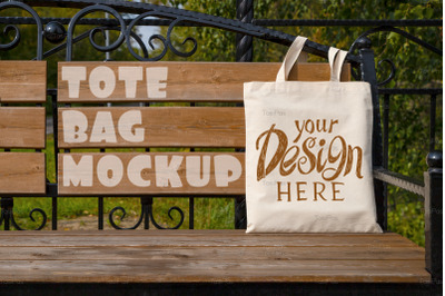 Rustic tote bag on the garden bench mockup
