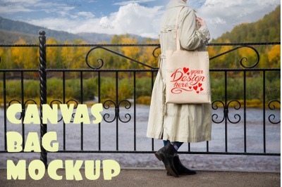 Woman in beige trench holding tote bag mockup