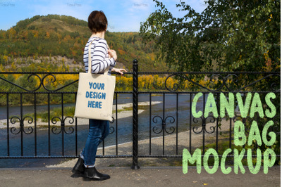 Woman holding tote looking at the river mockup