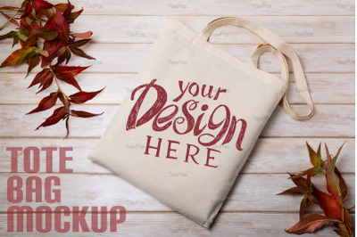 Rustic tote bag mockup with red wild grass.