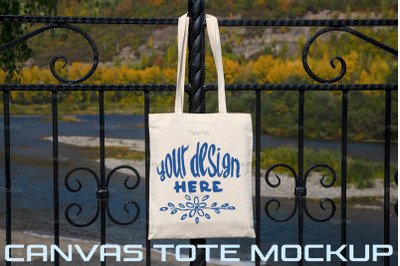 Rustic tote bag on the park fence mockup