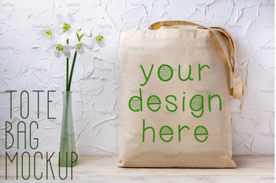 Rustic tote bag mockup with white lilies in the vase.
