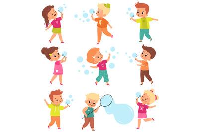 Soap bubbles show. Kids blow foam bubble, happy little girls and boys