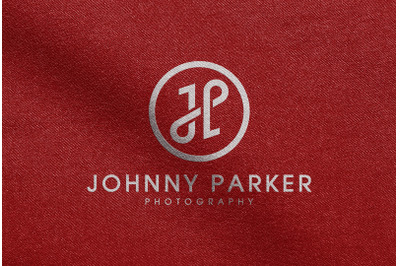 White Logo Mockup printed on Red Fabric