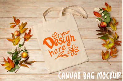 Rustic tote bag mockup with fall leaves and ghostberry.
