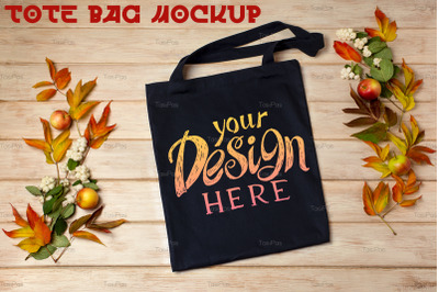Black tote bag mockup with fall leaves and snowberry
