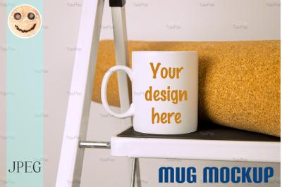 White coffee mug mockup with stepladder.