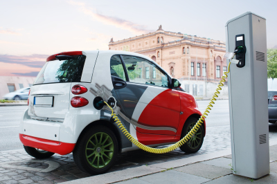 Electro car is charging on the street.