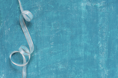 Blue holiday background with ribbon