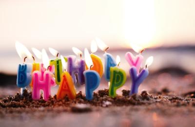 Birthday candles burning on a seashore