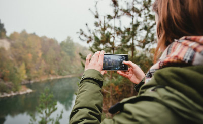 Girl shooting a nature by smartphone