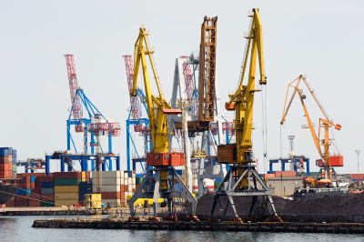 Industrial cranes and cargo on a quay