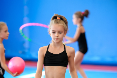 Girls exercising during gymnastics class