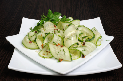 Acute appetizer of fresh cucumbers with garlic, dill, spices